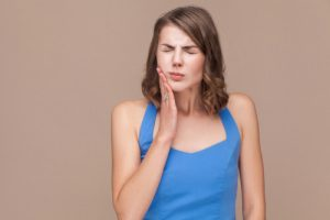 woman with toothache causing headache and earache