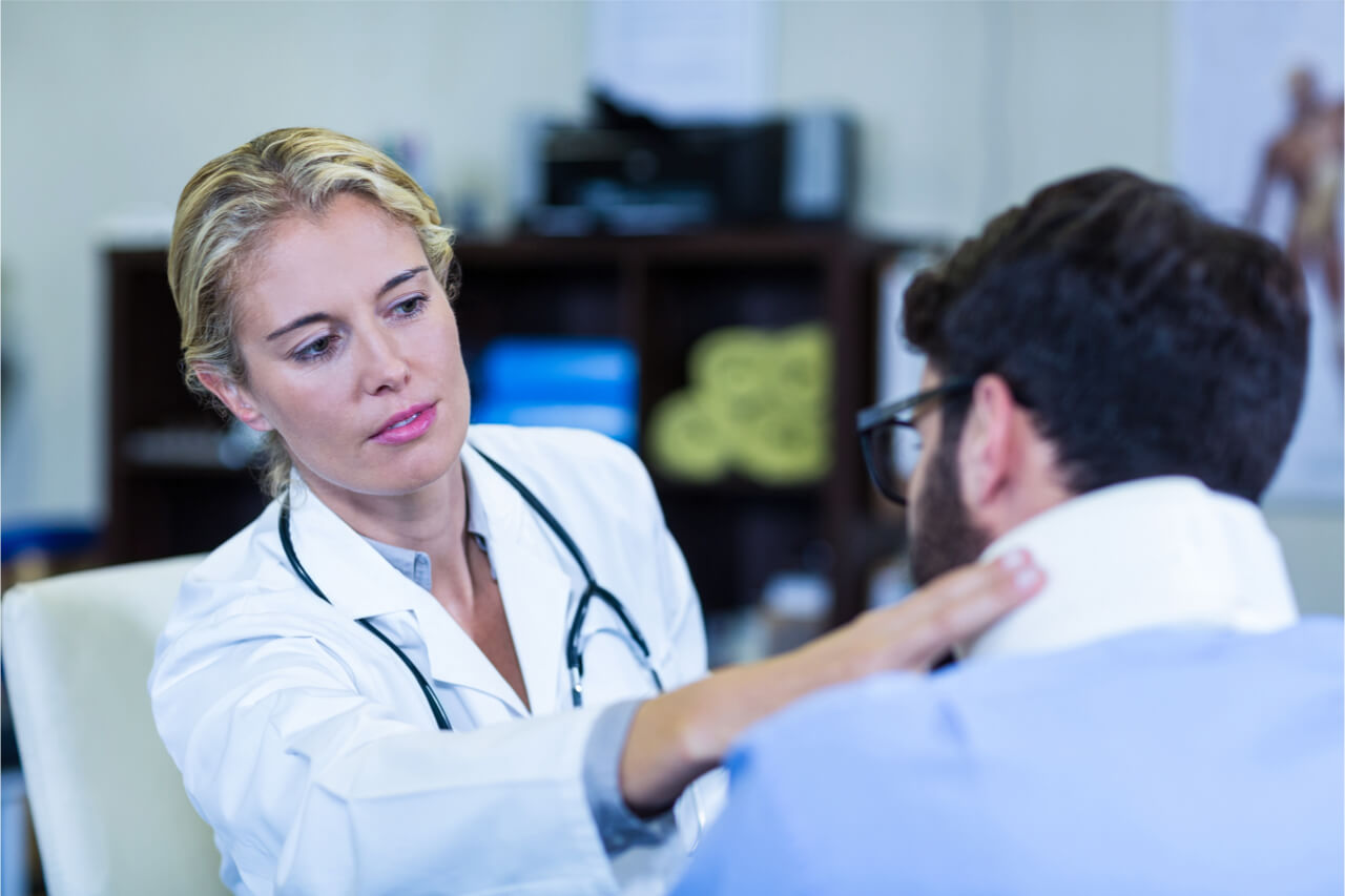 doctor checking a patients neck