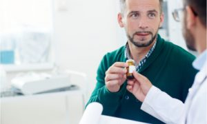 Doctor Explaining Oral Cancer Facts to Male patient