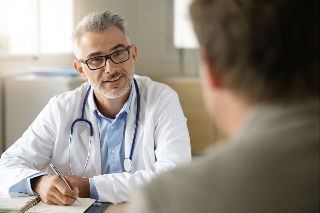 The doctor is asking the patient about his medical history.